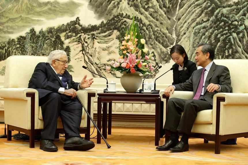 China's Foreign Minister Wang Yi (right) meeting former US Secretary of State Henry Kissinger at the Great Hall of the People in Beijing on Nov 22, 2019.