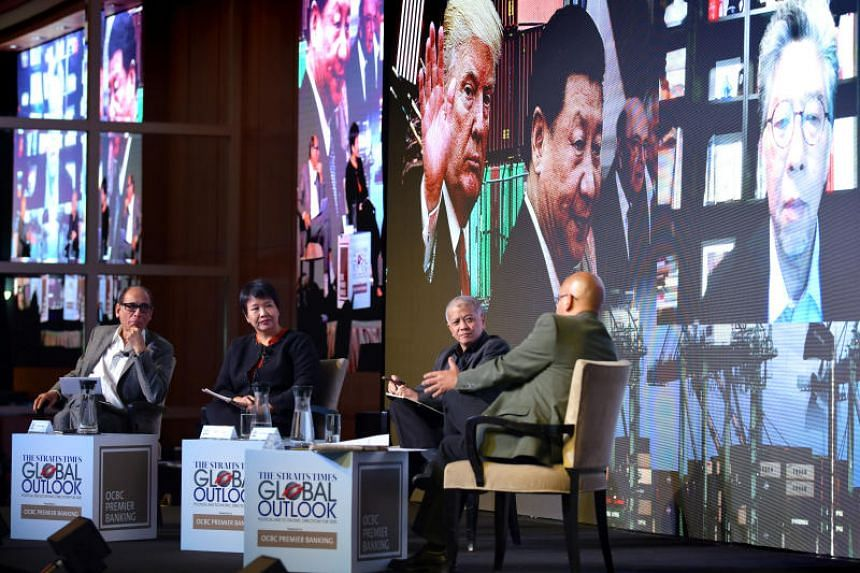 (From left) Straits Times associate editor Vikram Khanna; OCBC head of treasury research and strategy, global treasury Selena Ling; Professor Danny Quah, dean and Li Ka Shing Professor in Economics, Lee Kuan Yew School of Public Policy; and ST's US b