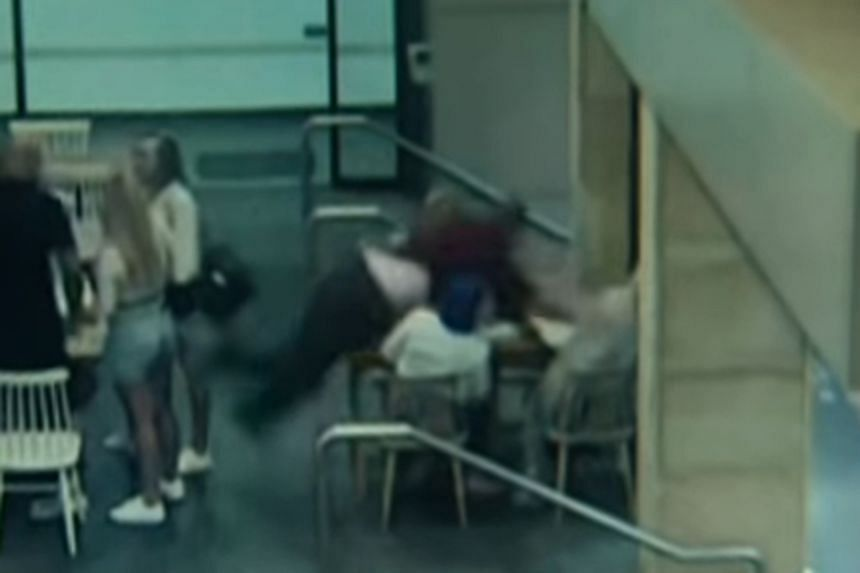 Seemingly without provocation, the suspect is seen lunging over the table to attack a woman, who police said is 38 weeks pregnant.