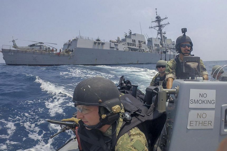 US warships sail in disputed South China Sea, angering Beijing