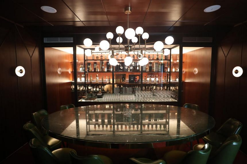 Tasting Room is an exquisite private saloon where members experience the club's collection of the finest whiskeys and wines.