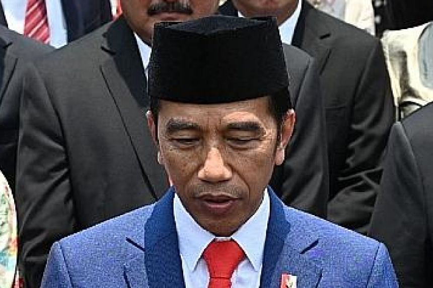 Indonesian Coordinating Maritime Affairs and Investment Minister Luhut Pandjaitan (left) said Indonesian President Joko Widodo wants his retirement home to be built in his hometown in central Java, instead of Jakarta like previous presidents. PHOTO: