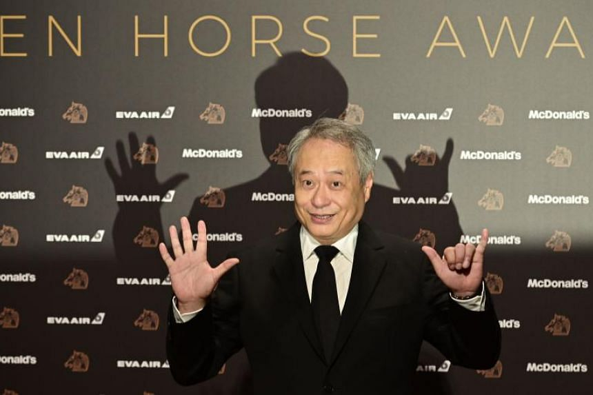 Taiwanese film director Ang Lee arrives on the red carpet of the Golden Horse Awards.