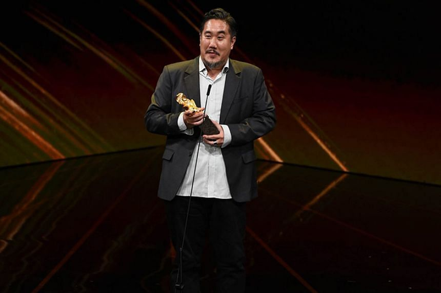 Singaporean music composer Teo Wei Yong receiving the award for Best Original Film Score for A Land Imagined.