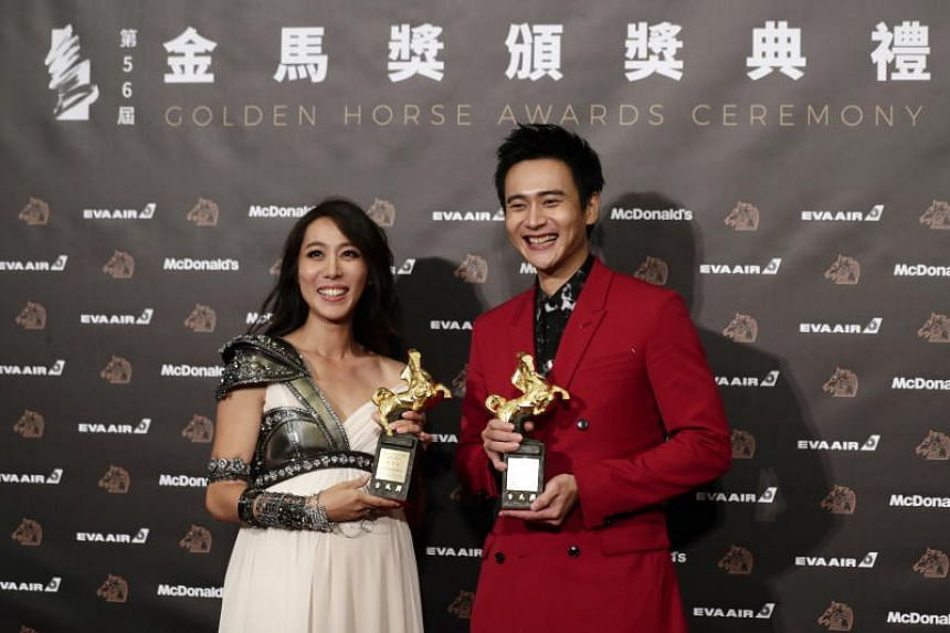 Taiwanese actors Winnie Chang and Liu Kuan-ting with their trophies after winning the Best Supporting Actress and Actor awards for their roles in The Teacher and A Sun respectively.