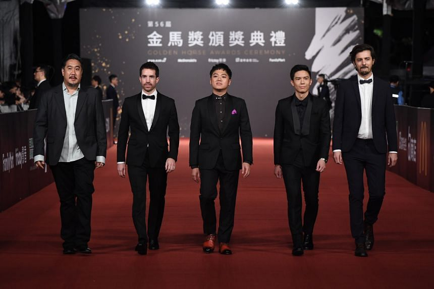 A Land Imagined director Yeo Siew Hua (centre) leads his team at the Golden Horse Awards. The film is up for four awards including Best Original Screenplay.
