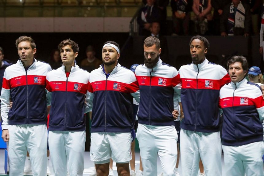 French Davis Cup team players listen to the national anthems before the group stage tie between France and Japan.