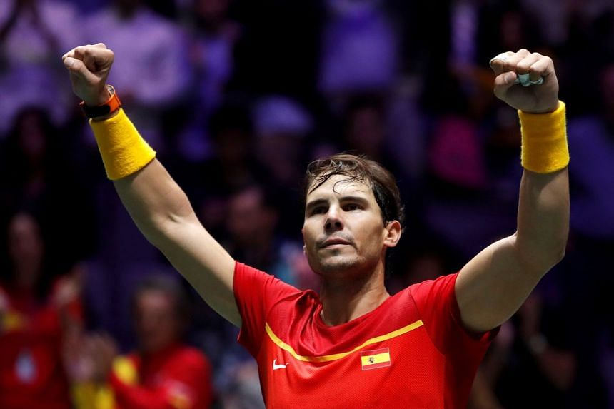 Nadal celebrates his win over Britain's Daniel Evans in the second match of the Davis Cup semi-final.