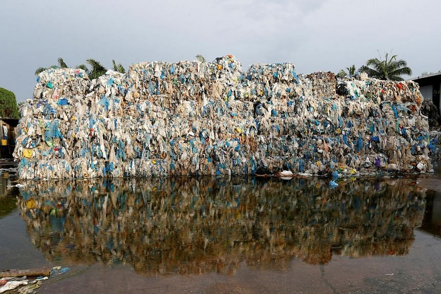 Plastic waste piled outside an illegal recycling factory in Jenjarom, Selangor. By the end of last year, more than 800,000 tonnes of plastic waste was imported into Malaysia, including illegal, often contaminated, waste from richer nations keen to ge