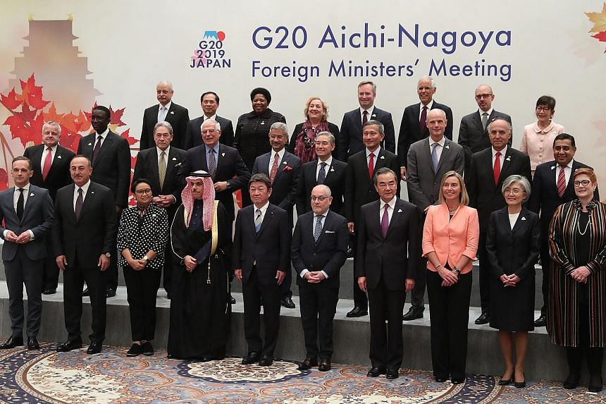 Singapore Foreign Minister Vivian Balakrishnan (middle row, fourth from right) with his counterparts and representatives at the G-20 Foreign Ministers' Meeting in Nagoya yesterday. Among the foreign ministers were South Korea's Ms Kang Kyung-wha (fro