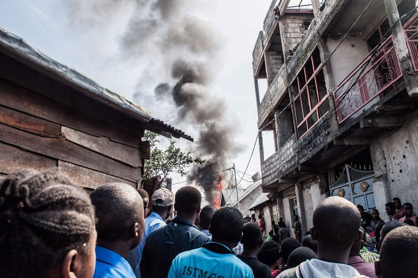 Smoke is seen rising from the site of the crash of a Busy Bee airplane, in Goma, Democratic Republic of Congo, on Nov 24, 2019.