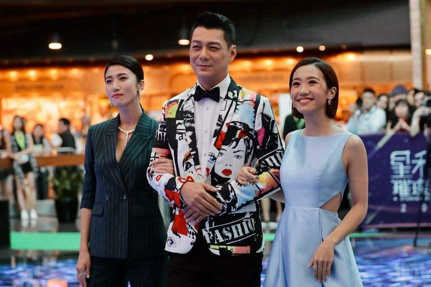 (From left) Kate Pang, Dennis Nieh and Lulu Huang on the green carpet at StarHub's Night of Stars at the Marina Bay Sands on Nov 24, 2019.