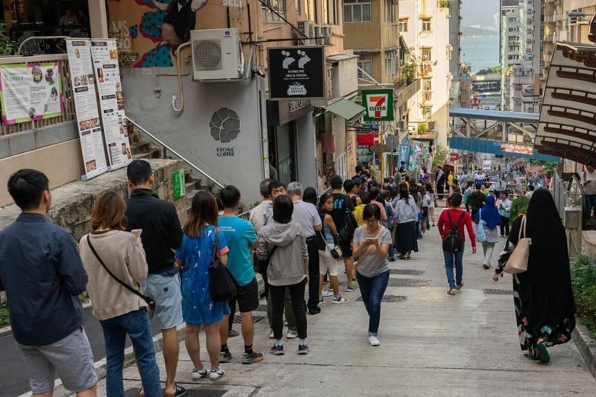 People queueing at a local polling station to cast their vote for the Hong Kong district council election, on Nov 24, 2019.