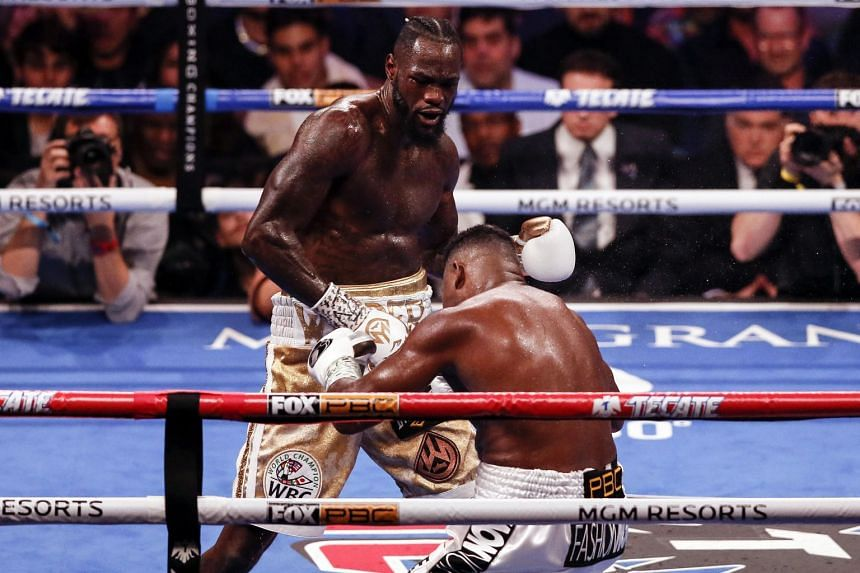 Deontay Wilder of the (top) knocks out Luis Ortiz II during their bout at the MGM Grand Garden Arena in Las Vegas, Nevada, on Nov 23, 2019.