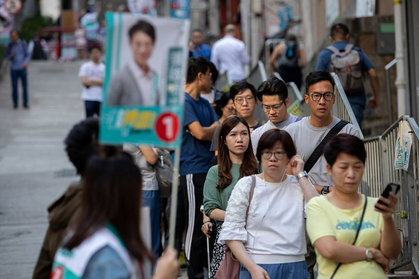 Residents lining up to cast their vote in the District Council Ordinary Election in Hong Kong, on Nov 24, 2019.