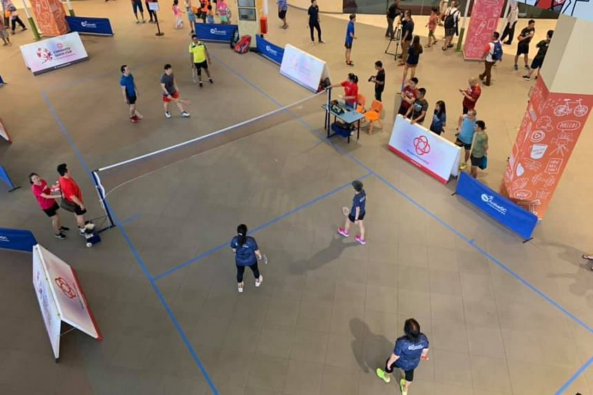 People playing Air Badminton at the atrium at Heartbeat@Bedok, on Nov 23, 2019.