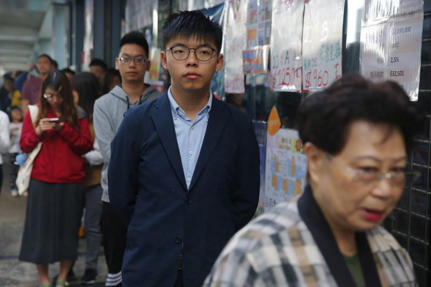 Democracy activist Joshua Wong waiting in line to cast a vote in Hong Kong, on Nov 24, 2019.