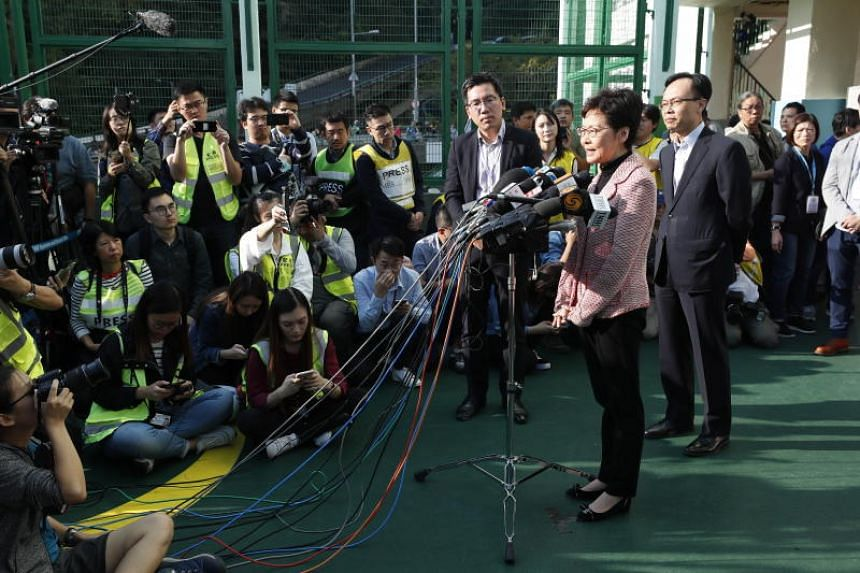 Hong Kong Chief Executive Carrie Lam speaks to the media after casting her vote, on Nov 24, 2019.