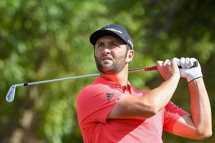 Jon Rahm playing a shot in the final round of the DP World Tour Championship in Dubai yesterday. He won US$3 million (S$4 million) for his one-shot win and another US$2 million for topping the money list.