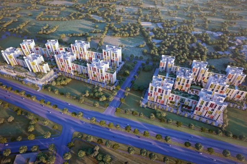 An artist's impression of the aerial view of a Gujarat township designed by Surbana Jurong. The Temasek-owned firm is master planning and designing affordable homes under a project awarded by the Gujarat Housing Board.