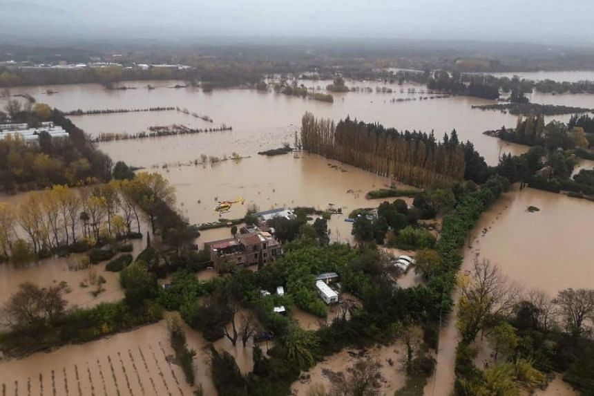 A handout picture taken and released by the French civil defence on Nov 24, 2019, shows an aerial view of flooded areas following heavy rains in Le Luc, south-eastern France.