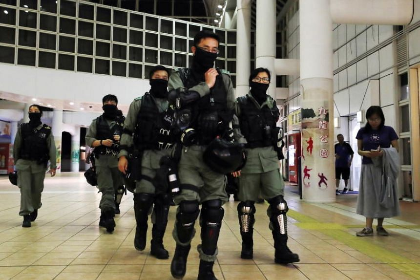 Riot police patrol a polling station as voting officially closes in Hong Kong, on Nov 24, 2019.