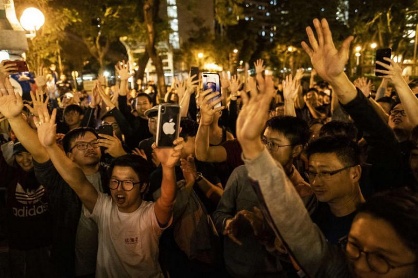 Pro-democracy supporters celebrate results outside a polling station in the Tuen Mun area of Hong Kong on Nov 25, 2019.