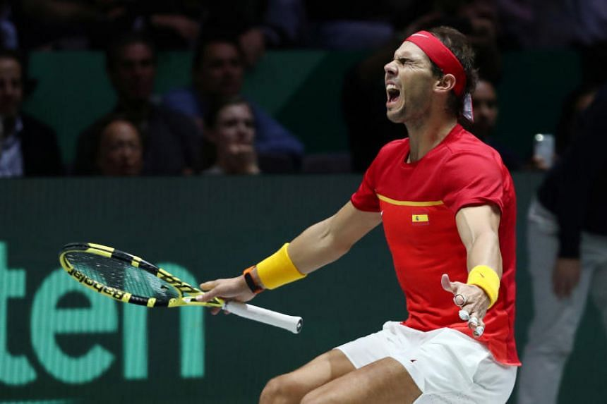 Spain's Rafael Nadal celebrates after winning his match against Canada's Denis Shapovalov and winning the Davis Cup in Madrid on Nov 24, 2019.