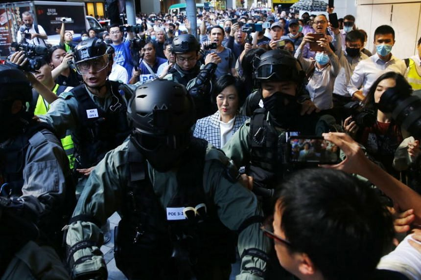 Regina Ip, a member of the Hong Kong government's leading advisory body and a former security chief, was loudly heckled on the streets of Central by lunchtime protesters on Nov 25, 2019.