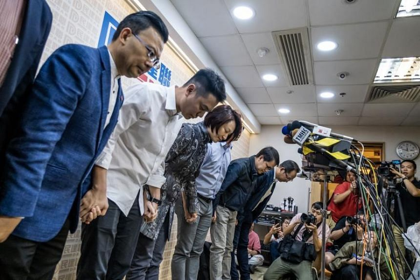 Democratic Alliance for the Betterment and Progress of Hong Kong chairman Starry Lee (centre) and other party members bow during a news conference in Hong Kong on Nov 25, 2019.