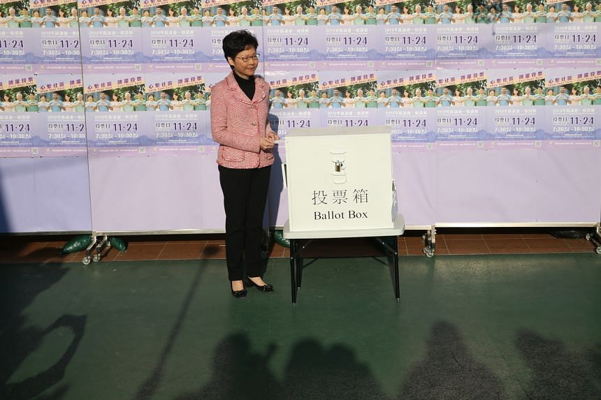 Hong Kong Chief Executive Carrie Lam casts her vote in the District Council Ordinary Election in Hong Kong, on Nov 24, 2019.