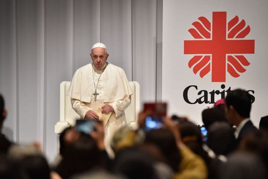 """Pope Francis attends a meeting with victims of the 2011 """"triple disaster"""" in Tokyo, on Nov 25, 2019."""
