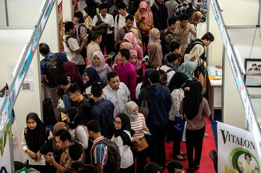 A photo taken on Sept 10, 2019, shows Indonesian job seekers at a job fair in Surabaya.