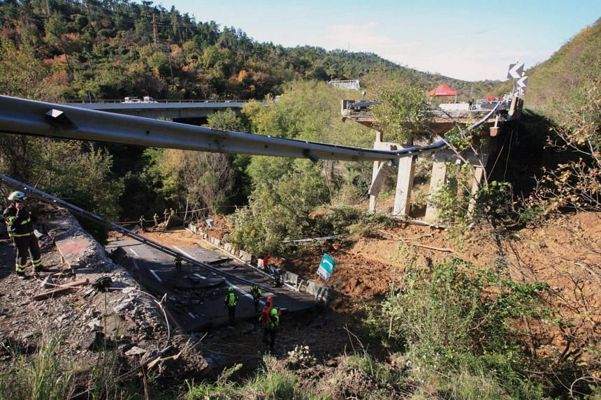 Firefighters work in the area where a stretch of the Turin to Savona A6 highway collapsed following heavy rains on Nov 25, 2019.
