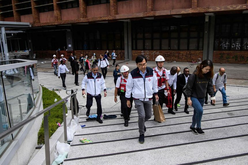 A team including university management, security guards, counsellors and the Hong Kong Red Cross searching for any remaining protesters hiding at the Hong Kong Polytechnic University on Nov 26, 2019.