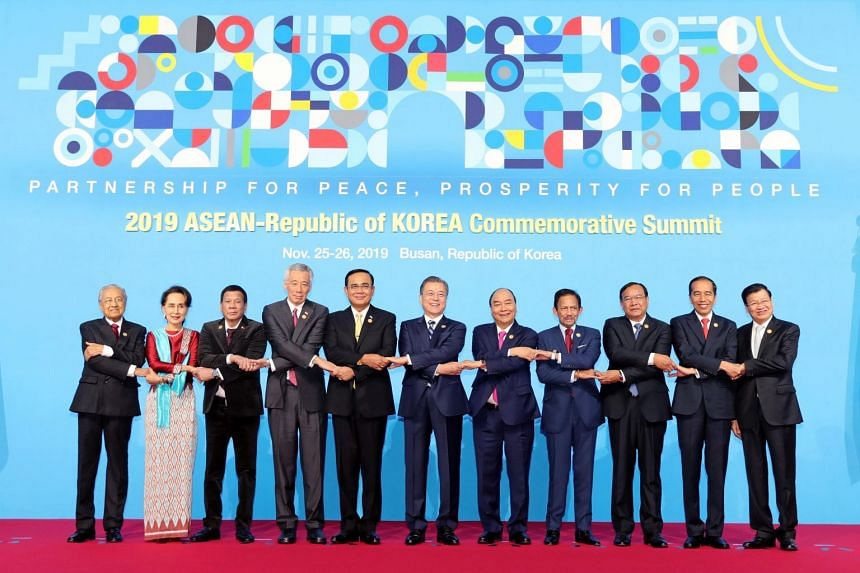 Prime Minister Lee Hsien Loong (fourth from left), other leaders of Asean countries and South Korean President Moon Jae-in (sixth from left) at the Asean-ROK Commemorative Summit in Busan on Nov 26, 2019.