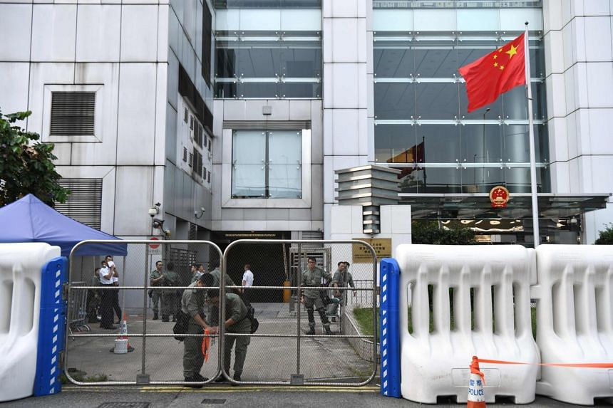 Ordinarily, communications between Beijing and Hong Kong are conducted through a Chinese government body: the Liaison Office of the Central People's Government in Hong Kong (pictured).