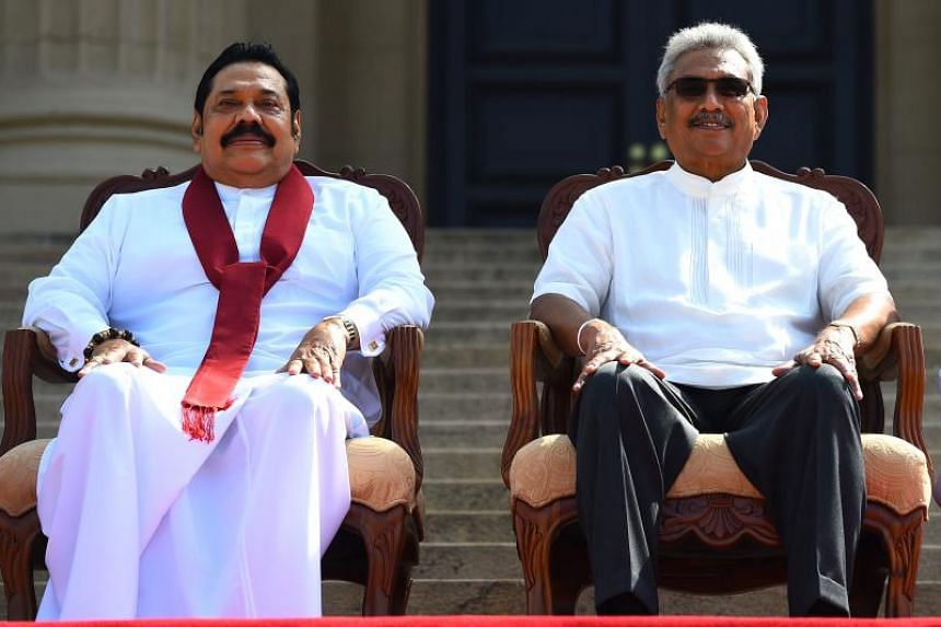 Sri Lanka President Gotabaya Rajapaksa (right) and his Prime Minister brother Mahinda Rajapaksa sit together after the ministerial swearing-in ceremony in Colombo on Nov 22, 2019.
