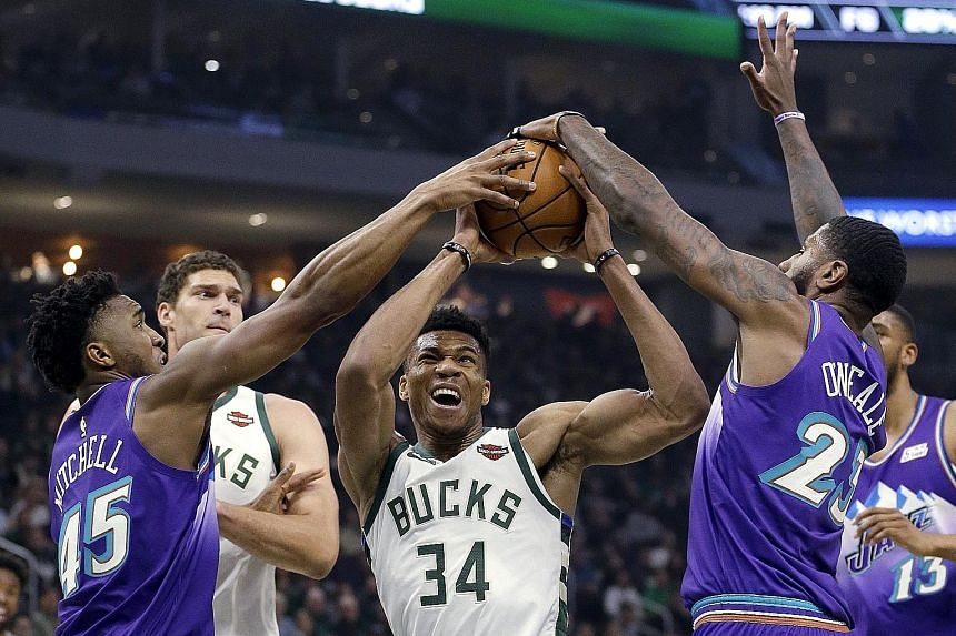 It took two opposition players in Utah's Donovan Mitchell and Royce O'Neale, and a foul, to stop Milwaukee's Giannis Antetokounmpo from driving to the basket in this play. The Bucks forward put in a dominant shift, scoring 50 in their 122-118 victory
