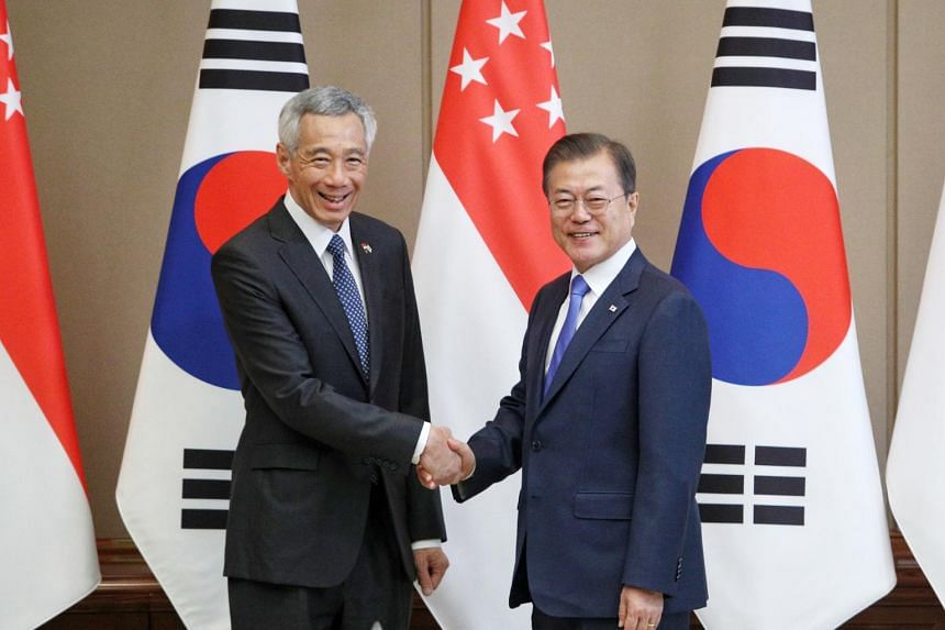 Prime Minister Lee Hsien Loong (left) shakes hands with South Korean President Moon Jae-in during their meeting at the presidential Blue House in Seoul on Nov 23, 2019.