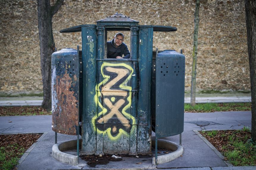 Curator Marc Martin in the last original public urinal from the 19th century located just outside the walls of the Sante prison in Paris.