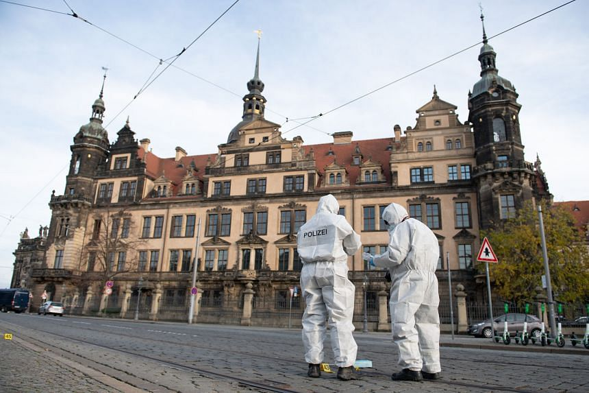 Above: Two forensic officers working in front of Dresden Castle, after the Green Vault was broken into early on Monday morning.