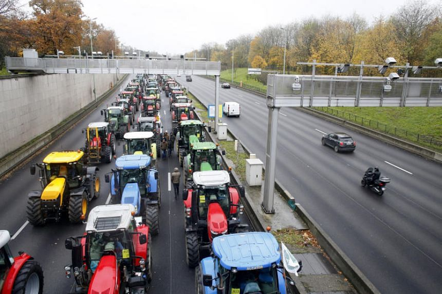French tractors roll into Paris to protest 'agri-bashing'