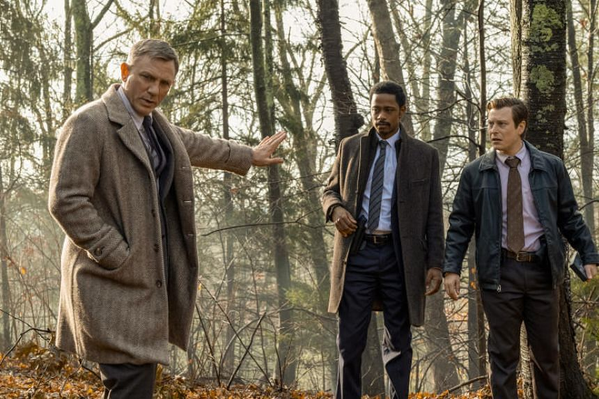 Daniel Craig (left) plays a famous private detective brought to help local law enforcement, played by Lakeith Stanfeld (centre) and Noah Segan, when a millionaire novelist dies under mysterious circumstances.