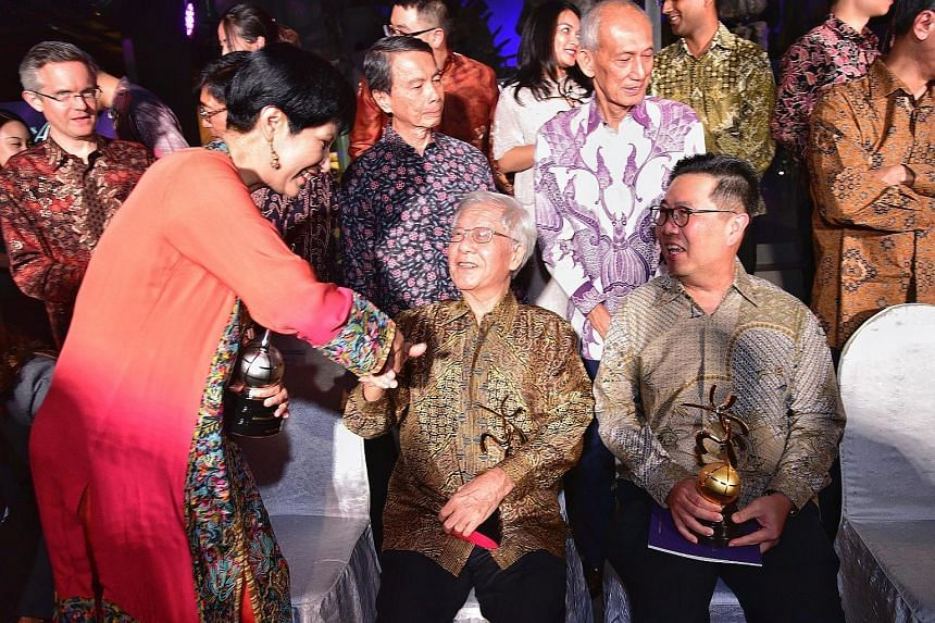 Ms Indranee Rajah, Minister in the Prime Minister's Office and Second Education and Finance Minister, greeting former chief justice Chan Sek Keong at the awards ceremony. Next to Mr Chan is Dr Kelvin Ngiam, son of former top civil servant Ngiam Tong
