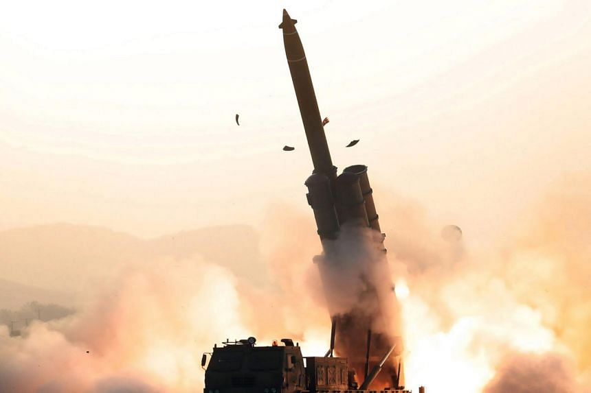 A photo taken on Oct 31, 2019, shows the North Korean Academy of Defence Science making a test-fire of a super-large multiple rocket launcher at an undisclosed location.