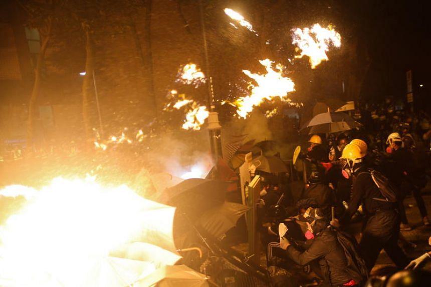 Pro-democracy protesters clashing with the police outside Hong Kong Polytechnic University on Nov 16, 2019.