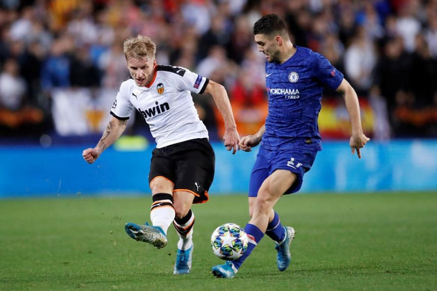 Valencia's Daniel Wass (left) in action with Chelsea's Mateo Kovacic during their Champions League football match in Valencia, Spain, on Nov 27, 2019.