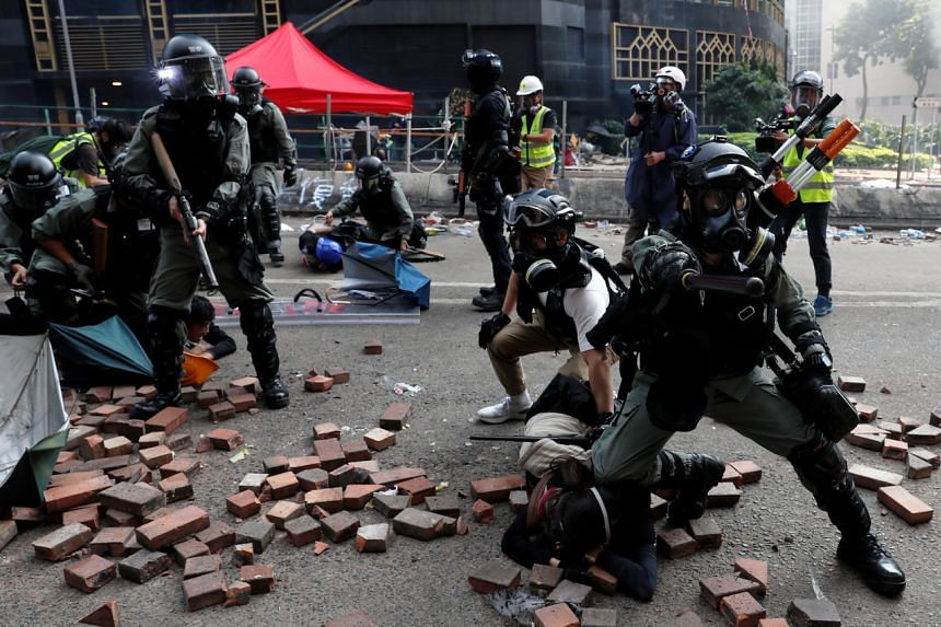 Police detain protesters who attempt to leave the campus of Hong Kong Polytechnic University during clashes with police in Hong Kong, on Nov 18, 2019.