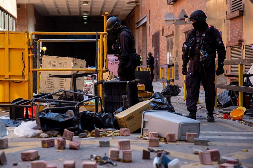 Officers from a bomb disposal unit search the campus of Hong Kong Polytechnic University, on Nov 28, 2019.